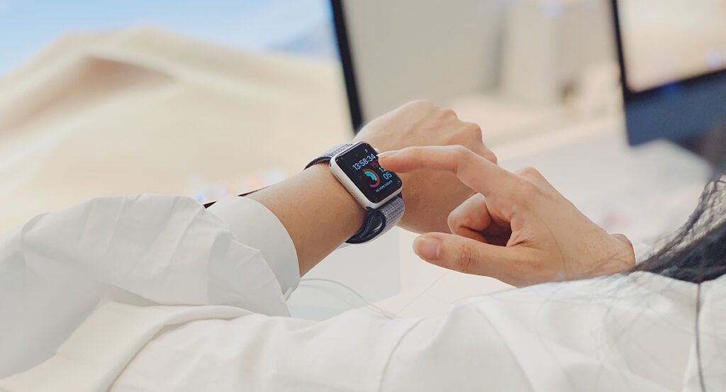 Woman wearing an iWatch checking her activity